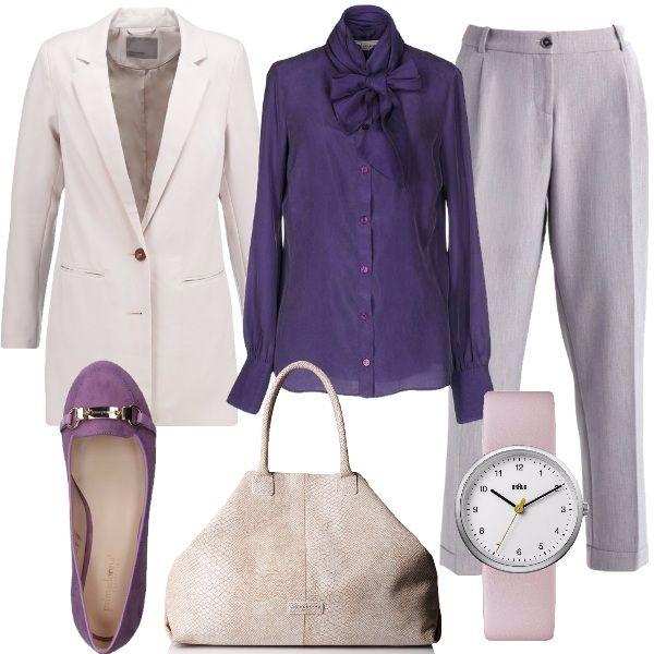 Stile sofisticato dalle linee pulite e raffinate, adatto a contesti formali dove l'eleganza è protagonista. Giacca con collo a bavero, dalla vestibilità regolare, camicia in seta, nella nuance del viola, con collo alla coreana e fiocco, pantalone a vita alta, con lunghezza alla caviglia. Mocassini dall'effetto scamosciato, con applicazione in metallo dorato e tacco flat, borsa a mano in pelle, orologio con cinturino in rosa chiaro e quadrante in acciaio.