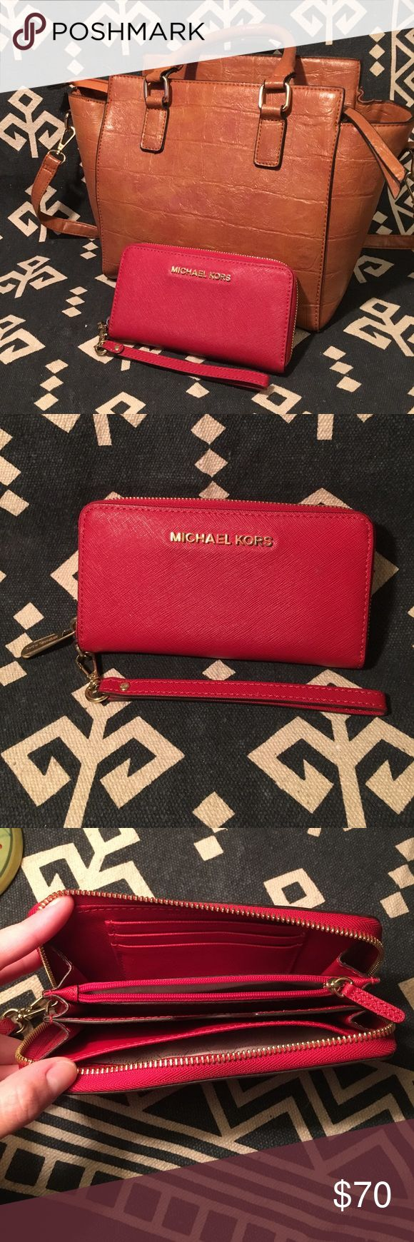 Michael Kors Jet Set Continental Wallet Michael Kors Jet Set Continental wallet in Burnt Red. Minor flaws showed- small stain on inside zippered pocket and scratch marks on the zipper. Gold hardware. Michael Kors Bags Wallets