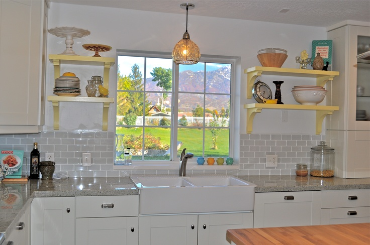 My favorite part of the kitchen the tile, then the yellow shelves and last the hanging light fixture above the sink!