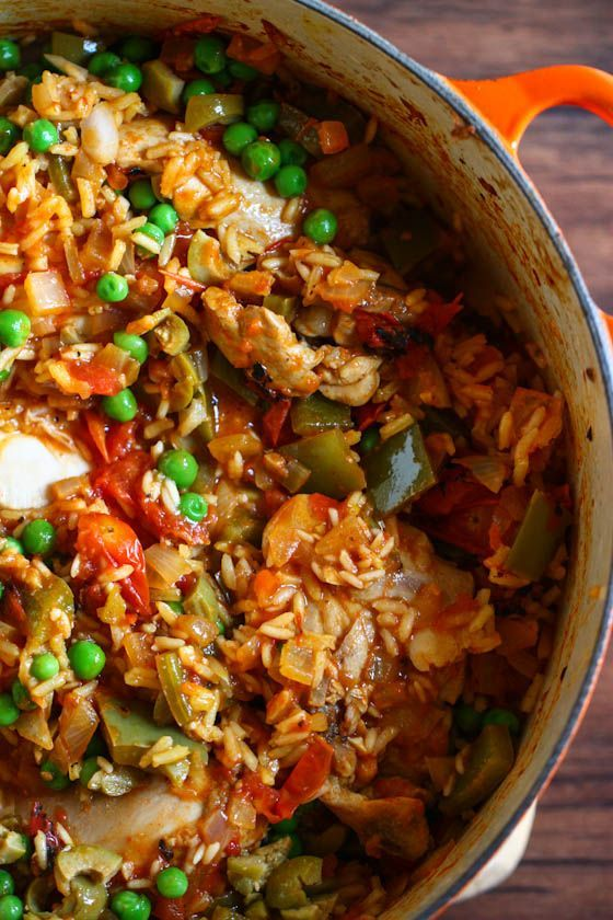 Arroz con pollo with chicken, garlic, bell peppers, rice, and fresh ...