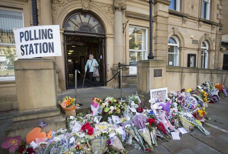 "Flowers for the local Labour MP Jo Cox lined the floor outside Batley Town Hall on EU referendum polling day. Mrs Cox was murdered in West Yorkshire a week before the vote. Prosecutors said her killer was motivated by hate and his crimes were ""nothing less than acts of terrorism""."