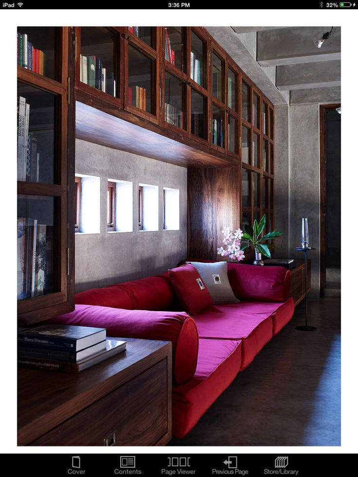 Surround enclosed bookcases warm up the contemporary space.
