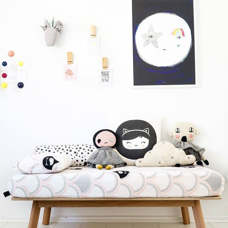 In this room you have a bit more colour but most of the colours are soft. Here they've used bedding, soft toys and a wall hook to add touches of colour and the result is a charming space that feels stylish yet playful.