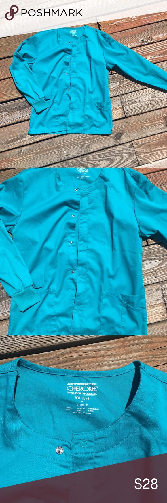 Cherokee WW Flex Teal Scrub Jacket Size Small Never worn, no tags. Size is small. The color is teal. The picture looks a lot lighter than the actual color. Cherokee Jackets & Coats Utility Jackets