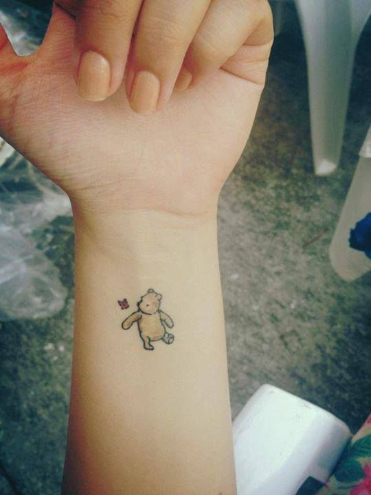 I don't think I'd ever get a bear tattoo but this one of Winnie the Pooh is super cute!