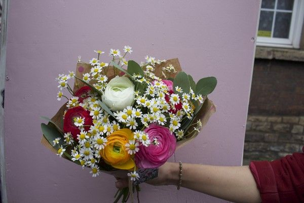 Giant Ranunculus and Tanacetum makes up this summery bouquet!