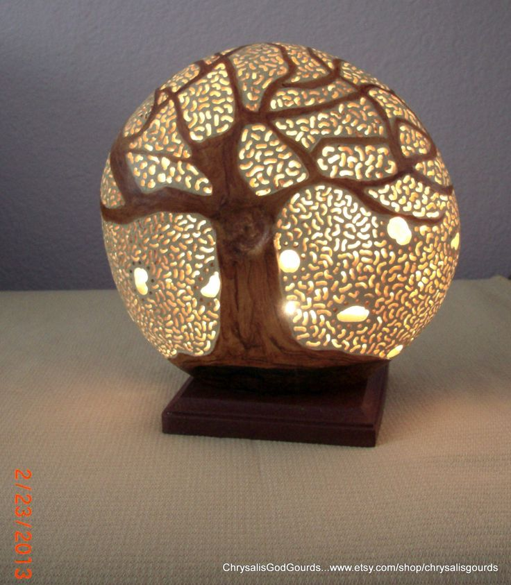 The Tree of Life Gourd luminary...8 in diameter and attached to a wooden stand. Small electric light inside