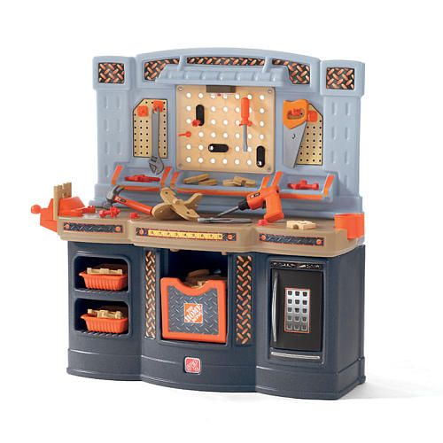 The Home Depot Big Builders Workshop playset includes 50 pieces! Comes with real work light working vise and handsaw. Wooden pieces are included so you can build four separate projects. There is tons of storage space so you can easily tuck away all your tools and accessories.