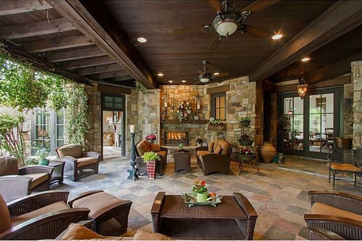 Craftsman Porch with Wrap around porch, French doors, exterior tile floors