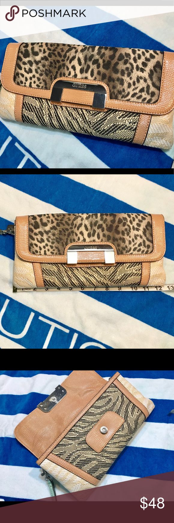 Super Cute Unique Guess Clutch! New Guess clutch super cute! Have a great day and feed someone along the way! #agodthang #shesagodthang #karenagodthangcumby #love #you Guess Bags Clutches & Wristlets
