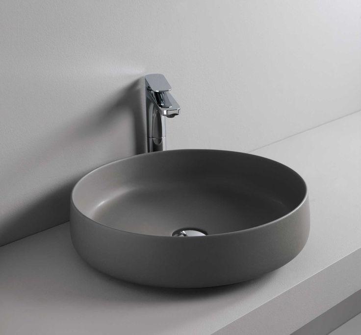 Cognac washbasin design Meneghello Paolelli Associati. Round shapes and very thin rims highlight the concepts of elegance and lightness. Gray olive. Thin-rim washbasins