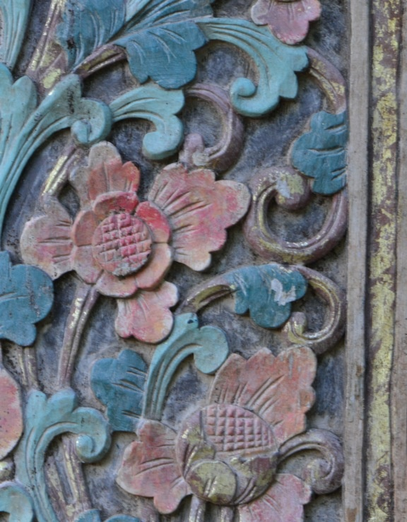 A Balinese flower. Soon to be cleaned up. We found a pair of doors in a funky store in MA that had our emerging home colors. What a collection of things they had:http://www.asiabarong.com/