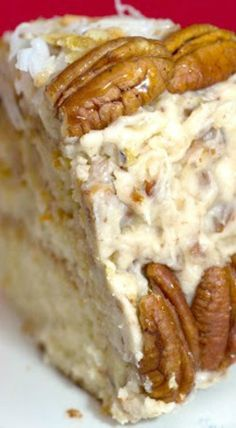 Fresh Orange Italian Cream Cake Recipe _ This Italian cream cake recipe is enhanced with a pecan & cream cheese frosting & sweet, tangy orange curd between the cake layers. Garnish with glazed pecans! | Southern Living December 2002! #ItalianCreamCake