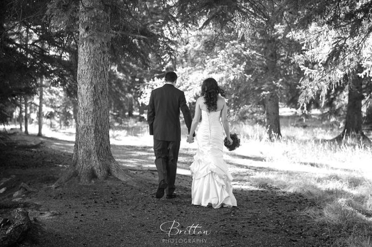 Bride and Groom in the woods in Jasper, Alberta.  Photo by Britton Photography.