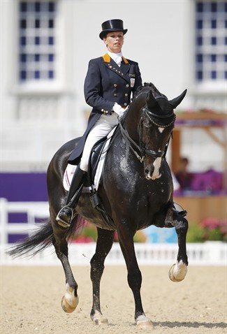Anky van Grunsven of the Netherlands riding Salinero performs during the equestrian Dressage Individual Grand Prix Freestyle at the London 2012 Olympic Games August 9.