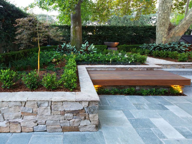 Eco Outdoor Alpine retaining wall, Endicott hand chipped paving and timber bench seat used in a contemporary courtyard design