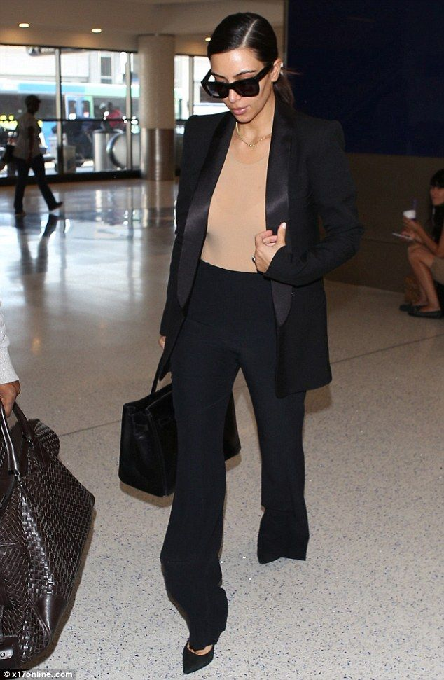 kim Kardashian at LAX  Stella McCartney pants, SaintLaurent pumps, Hermes Birkin bag So Black, Celine sunnies, Maison Martin Margiela bodysuit