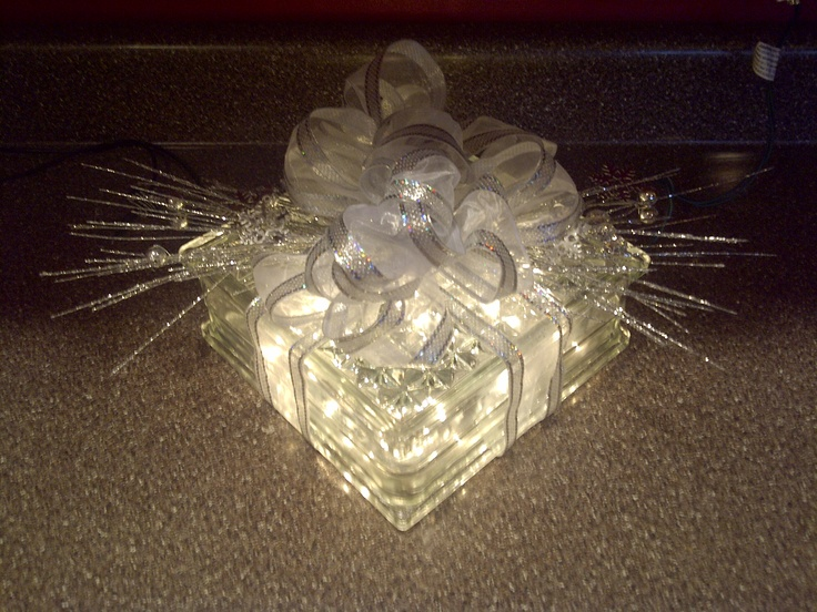 ** Clear Glass Block Decorated With White And Silver Ribbons And Indoor Lights