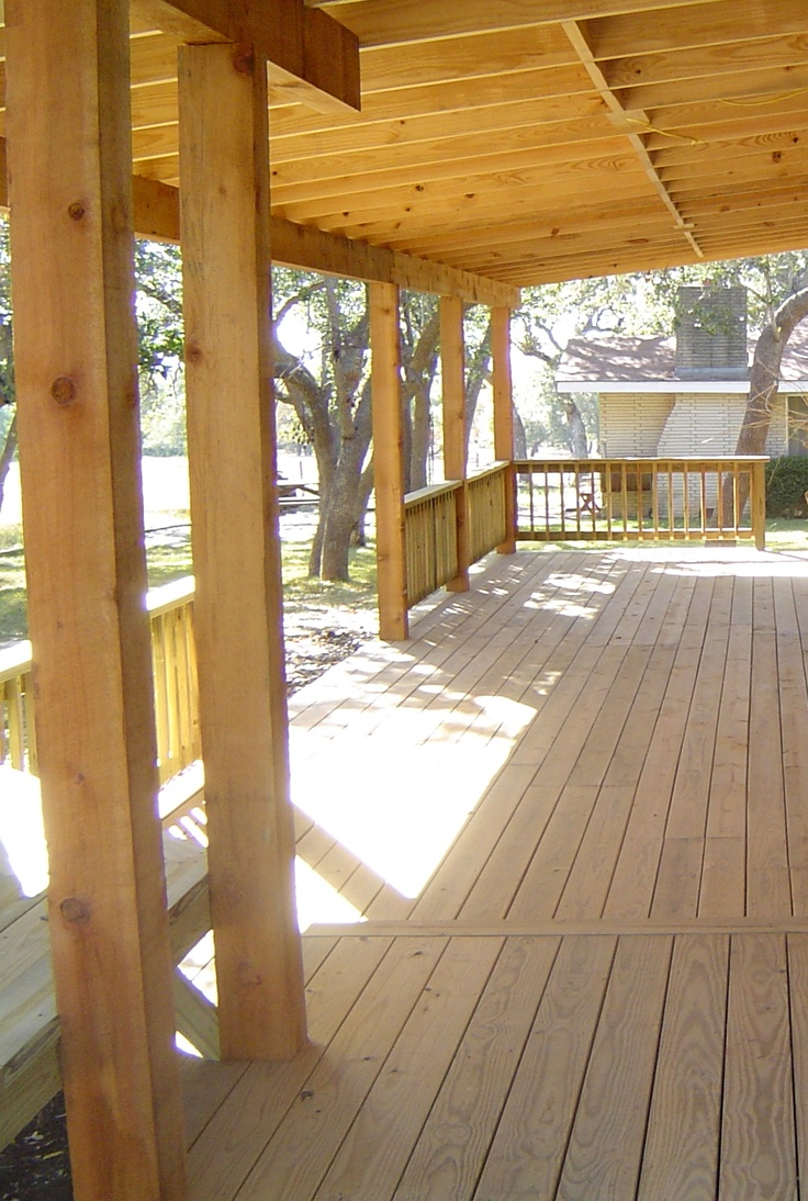 Covered Deck with new wood flooring adds a comfortable ...