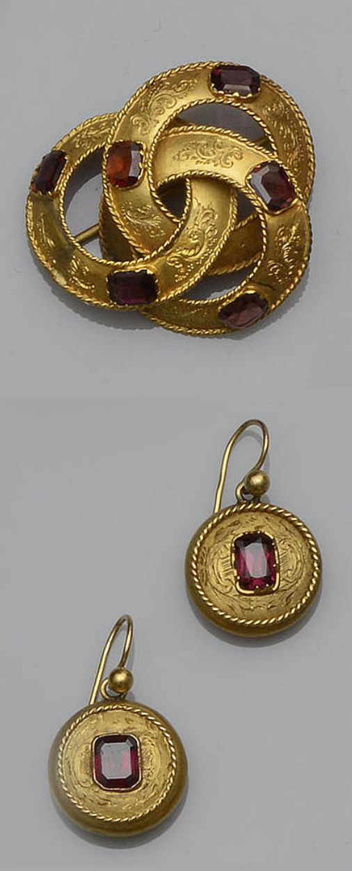 Victorian gem set jewellery suite comprising a ribbon knot brooch with engraved detail, set with mixed-cut garnets, with a pair of matching round drop earpendants