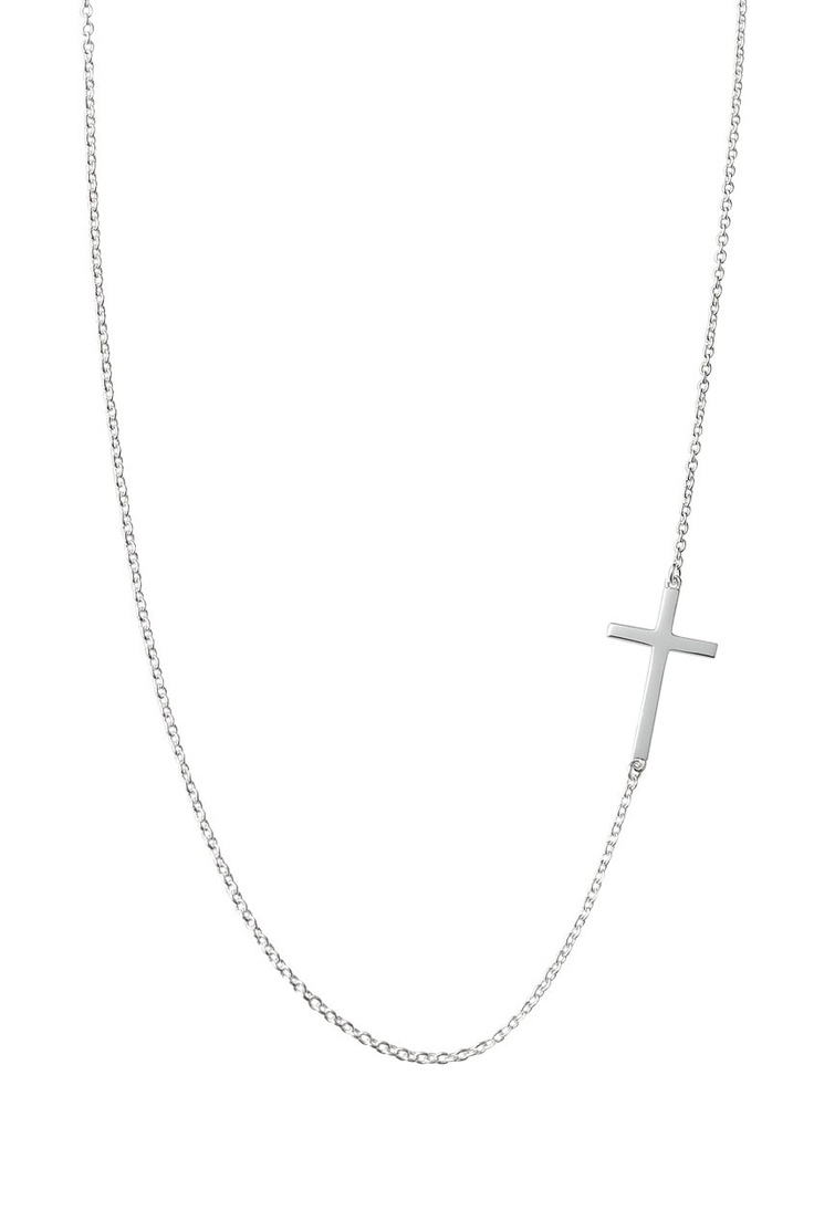 """A simple sterling silver cross placed vertically within a delicate sterling silver chain. 15 1/2"""" length plus 2"""" integrated extender. Lobster clasp. A Maya Brenner Collaboration Style. Lead & nickel safe. Maya Brenner is a twelve year industry veteran and a native of California. She brings experience and undeniable talent to her eponymous jewelry collection. Her celebrity following includes Jessica Biel, Penelope Cruz, Rachel Bilson, Cameron Diaz, Reese Witherspoon, and Demi Moore, just to…"""