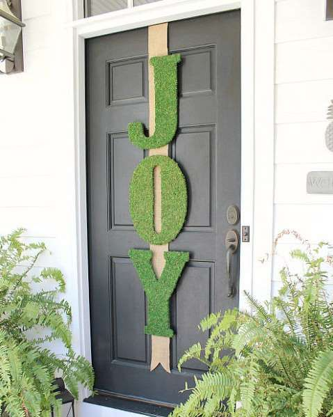 With just a few wooden letters strung up on your front door, you can spread Christmas cheer to your ... - Courtesy of Uncommon Designs Online