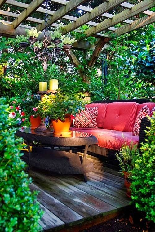 how to design an Outdoor tropical living room with plants and wood