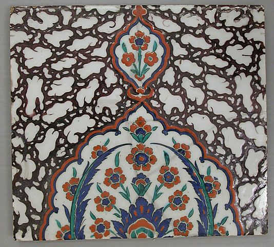 Tile with floral cartouche design on 'Ebru' (marble imitation pattern) background | Square tile, late 16th century | Made in Iznik, Turkey | Stonepaste; polychrome painted under transparent glaze | The Metropolitan Museum of Art, New York