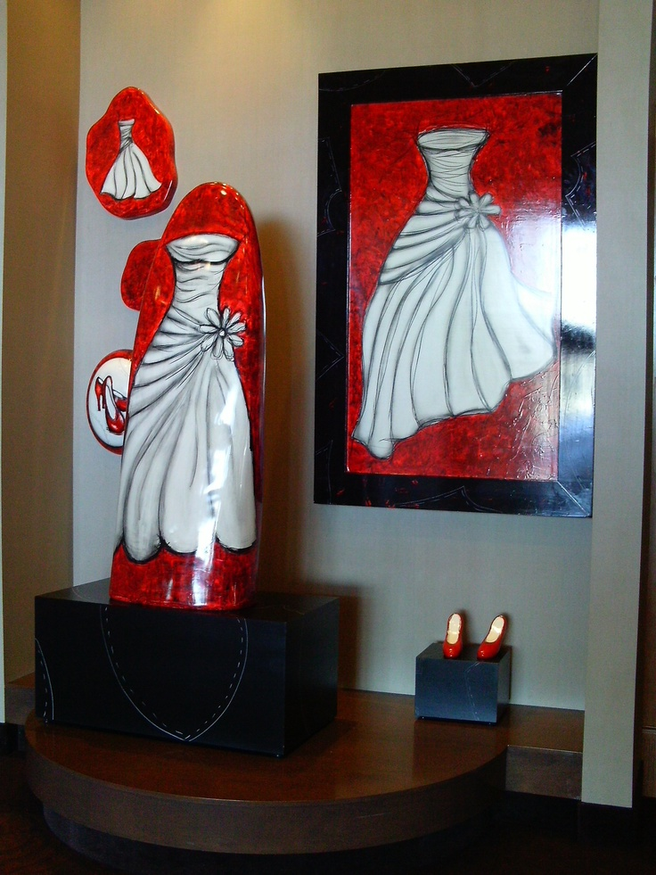 The unique dress sculpture, complete with accessories, is a focal point outside our Regal Ballroom.