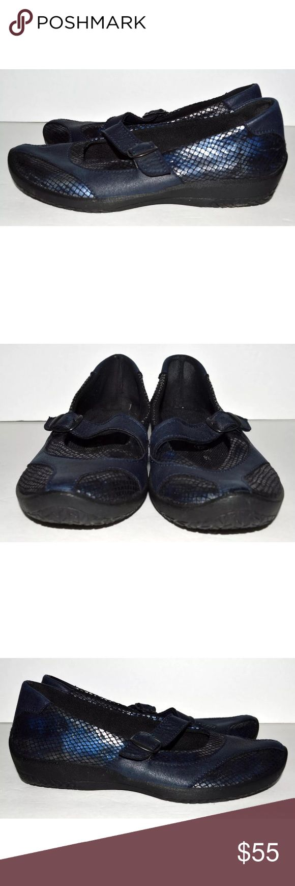 Arcopedico 38 Blue Metallic Mary Jane Shoes $135 Arcopedico 38 Blue Metallic Mary Jane Shoes $135  CONDITION: Pre-owned and stored in a smoke free / dog friendly home. Wear from use as pictured such as scuffing, marks, sole, and footbed wear.  Please see all photos and use the zoom option to make a personal assessment of the condition. The shoes have been wiped down but may require additional cleaning. Arcopedico Shoes Flats & Loafers