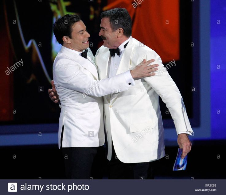 Download this stock image: Host Jimmy Fallon (L) and actor Tom Selleck embrace before Selleck is presented an award at the 62nd annual Primetime Emmy Awards in Los Angeles, California, August 29, 2010. REUTERS/Lucy Nicholson (UNITED STATES - Tags: ENTERTAINMENT) (EMMYS/SHOW) - GR2X9E from Alamy's library of millions of high resolution stock photos, illustrations and vectors.