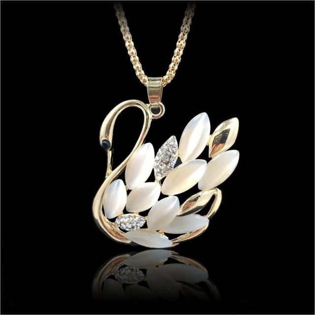 This unique piece is made with zinc alloy. The swan's feathers are made with opal and rhinestone accents. It is sure to be a conversaton starter! Part of our Animal Instincts jewellery Collection.