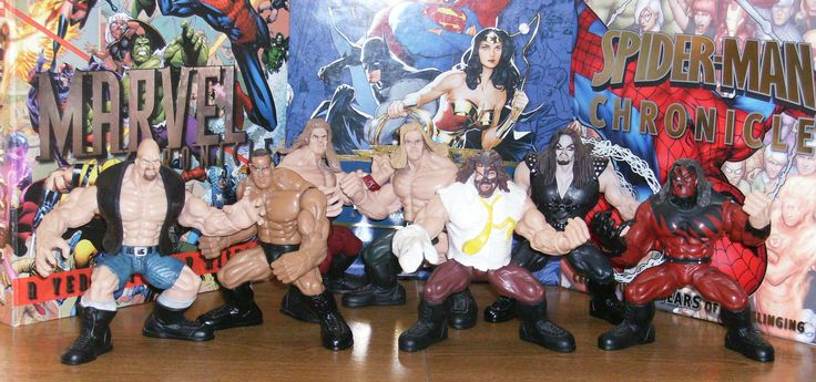 """L to R: """"Stone Cold"""" Steve Austin, The Rock, Shawn Michaels, Triple H, Mankind, The Undertaker, Kane."""