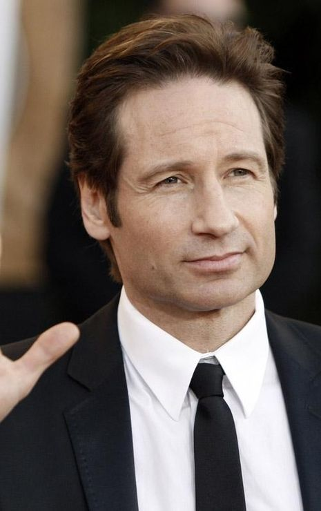 "David William Duchovny, American actor, screenwriter, producer, director, writer and musician. Two-time winner of the ""Golden Globe"" award (1997, 2008) for the role of the agent Fox Mulder in the TV series ""The X-Files"" and Lovelace-writer Hank Moody in the television series ""Californication."" Son emigrant native Brooklyn Amram Duchovny. Paternal grandfather, Moshe Spiritual emigrated to the US from Berdichev in 1918."