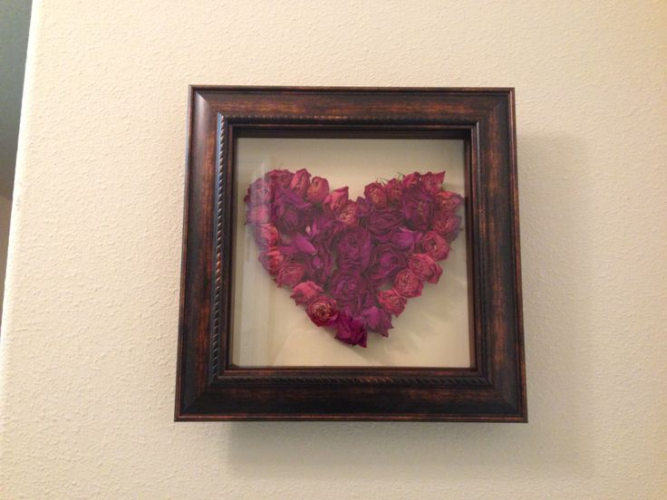 Dried rose petals in a shadow box This would be a great way to use the roses from Valentine's day!