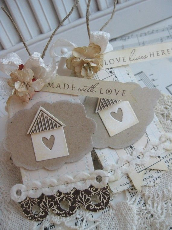 Two sweet little tags backed with chipboard for sturdiness, diecut labels, stamping, 3-d houses, felt borders, stitching, scallops,