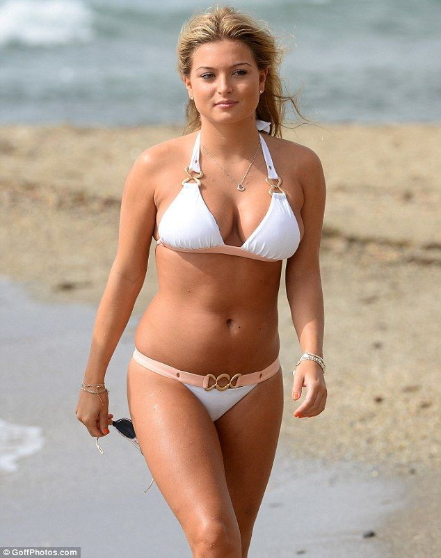 Just peachy! Sacked Miss GB Zara Holland, 20,  flaunted her killer curves in a white and peach halterneck bikini on her Marbella holiday