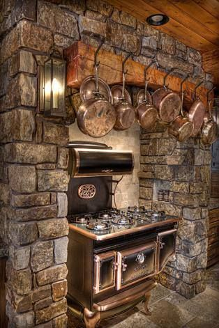 Rustic kitchen with copper stove and copper pots hanging above it - #WesternHome perfection!