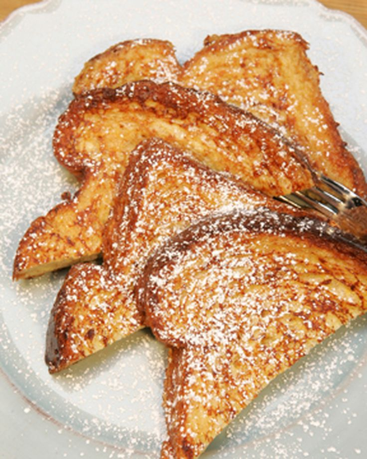 """Good cooks in many cultures have found delicious ways to revive stale or leftover bread. But the French take first prize with their simple recipe for pain perdu, literally """"lost bread,"""" which we have come to know as French toast. Once you've mastered the basics -- coating slices of bread in an egg-and-milk mixture and sauteeing them -- a range of possibilities opens."""