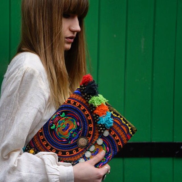 Sassy colourful clutch bag with embroidery, shredded pom poms and coin details