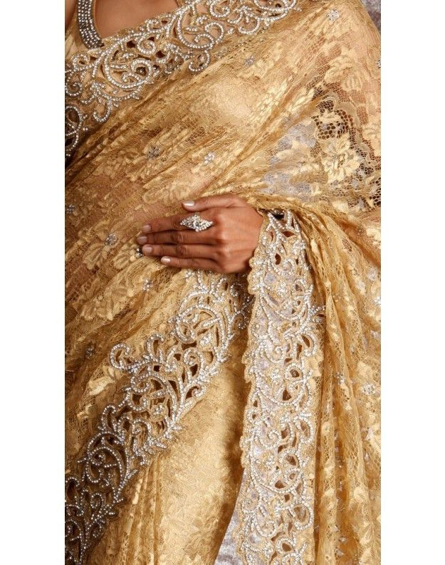 This saree is made of designer net in golden color having cut work zari border. This saree is made in high quality fabric having rich hand embroidery having diamond on it. Perfect designer piece for y