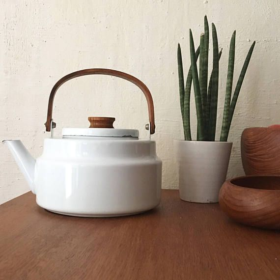 White enameled Scandinavian kettle and teak