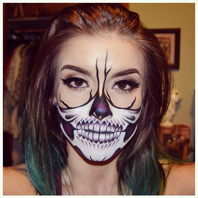 #halloweenmakeup inspo from @chrisspy half skull makeup look! I did this look using @mehronmakeup face & body paints in white and black, @sugarpill pressed eyeshadow in 2am, @meltcosmetics Promiscuous eyeshadow, @thekatvond @katvondbeauty Tattoo Liner and Ink Liner in Neruda, and @anastasiabeverlyhills #dipbrow in Chocolate