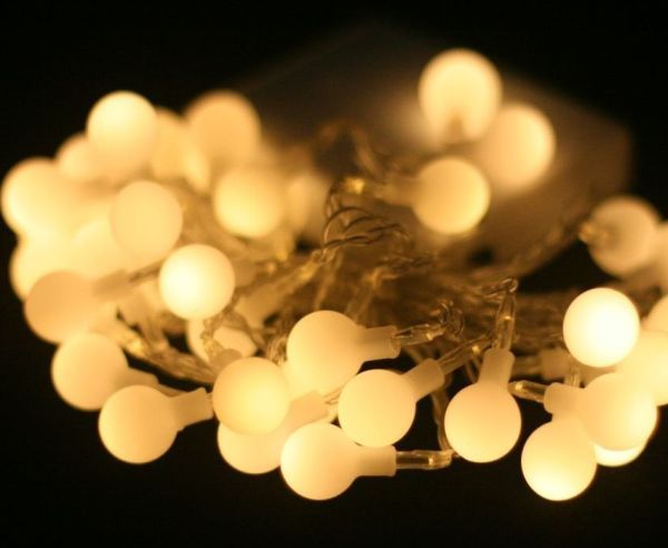 Warm White (soft white) LED Battery Lights on transparent wire.