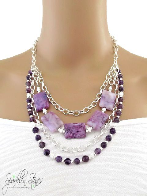 The Meghan Necklace... If purple is your color, then this is THE necklace for you. Shades of lilac swirled with deep rich plum tones are complimented by dark amethyst agate rounds.