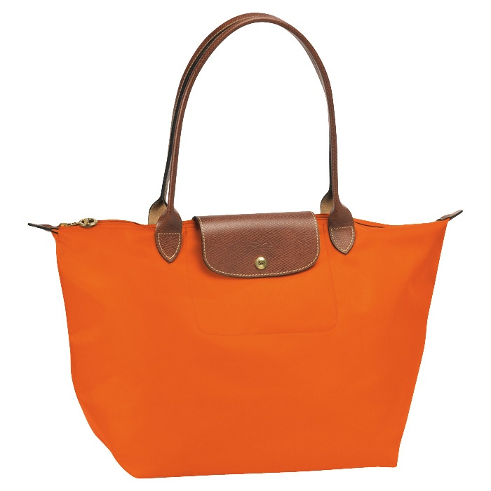 Longchamp Le Pliage in Orange <3. My husband loves orange and now I love orange. That sometimes happens.He at times has better taste then I do.Especially in furniture.