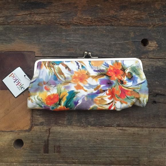 Poppie Jones Clutch Smell the flowers... Politically correct pleather floral clutch that reminds you of spring.  Magnet closure with zipper, drivers license and credit card holders when opened. 2 magnet clasps on each outer side lined with turquoise fabric. One side with zipper pocket. The other side with more credit card holders. Never used with tags. Poppie Jones Bags Hobos
