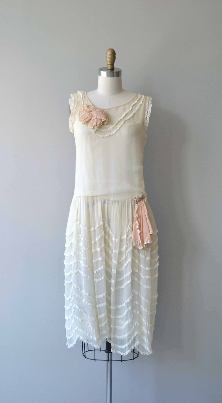Antique 1920s airy two-layer ivory silk dress with cream lace trim, undulating lace trimmed skirt, drop waist, blush silk chiffon rosette at the bodice and blush silk chiffon hip detail attached with rhinestone detail. --- M E A S U R E M E N T S --- fits like: small/medium bust: 32-35