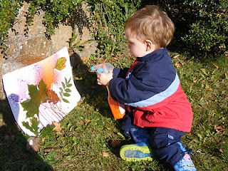 spray painting leaf silhouettes.  great idea for times we need to go outside, but the playground is occupied.