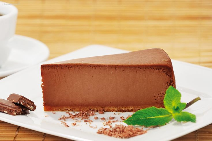 Chocolate Cheesecake  Chocolate Cheesecake is a classic of the genre. Natural dark chocolate in a duet with a delicate cream cheese Cheeseberry successfully combined with crunchy shortcake and create awesome taste, slightly reminiscent of chocolate creamy ice cream.